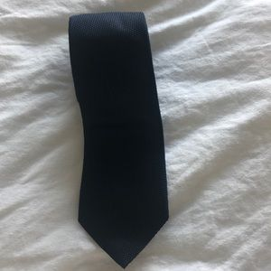 Hugo Boss dark blue tie.